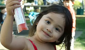 Kid holding Ice Pop | Fairyella Ice Pops all natural, healthy ice pops California